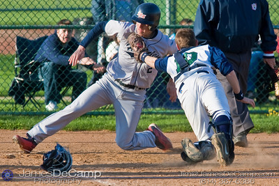 Tree of Life School's catcher #10 Grant Pauley reaches for the tag as Bishop Hartley High School's #2 Jack Imwalle comes in for a run Friday afternoon April 9, 2010 at the Ridgeview Middle School. (© James D. DeCamp | http://www.JamesDeCamp.com | 614-367-6366)