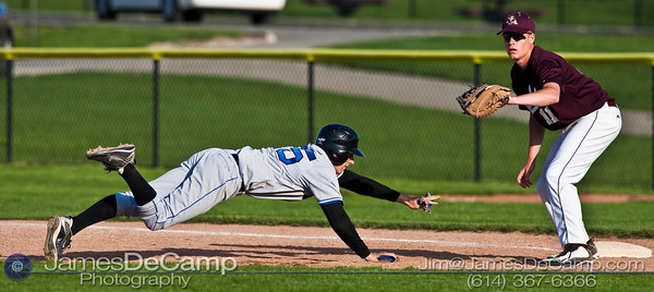 New Albany High School 's #11 Michael Van Straten makes the catch as Hilliard Bradley High School's #25 Ken Reichle makes a touch back to first base in the fourth inning of play at New Albany High School Wednesday afternoon April 14, 2010. (© James D. DeCamp   http://www.JamesDeCamp.com   614-367-6366)