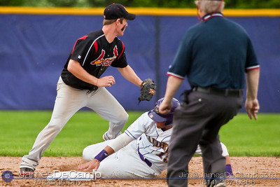 Reynoldsburg High School's #15 Jeff Murray slides safely into second base as St. Charles High Schools #7 Sam Kolp looks for the ball from a teammate in the second inning of play at Reynoldsburg Junior High School Thursday evening May 13, 2010. (©James D. DeCamp | http://www.JamesDeCamp.com | 614-367-6366)