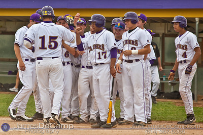 Reynoldsburg High School's #15 Jeff Murray is congratulated by his teammates after a home run against St. Charles High School at Reynoldsburg Junior High School Thursday evening May 13, 2010. (©James D. DeCamp | http://www.JamesDeCamp.com | 614-367-6366)