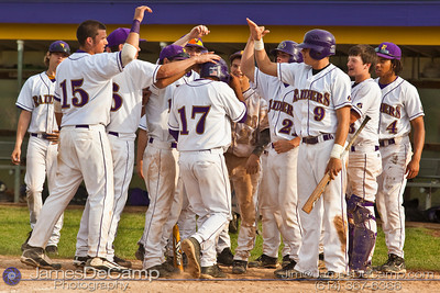 Reynoldsburg High School's #17 John Sheline is congratulated by his teammates after a home run against St. Charles High School at Reynoldsburg Junior High School Thursday evening May 13, 2010. (©James D. DeCamp | http://www.JamesDeCamp.com | 614-367-6366)