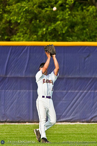 Reynoldsburg High School's #10 Drew Otani makes a catch of a pop up fly ball from St. Charles High School at Reynoldsburg Junior High School Thursday evening May 13, 2010. (©James D. DeCamp | http://www.JamesDeCamp.com | 614-367-6366)