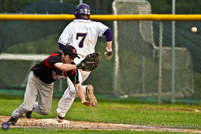 Reynoldsburg High School's #7 Weston Weiss safely makes it to first base as St. Charles High School's #11 Tony Francescon misses a throw at Reynoldsburg Junior High School Thursday evening May 13, 2010. (©James D. DeCamp | http://www.JamesDeCamp.com | 614-367-6366)