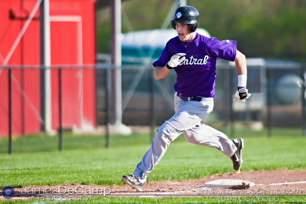 Pickerington Central High School's Zach Beaver (10) rounds third on his way to scoring in the fourth inning of play at the Groveport Madison High School Baseball fields Thursday afternoon April 21, 2011.  (© James D. DeCamp | 614-367-6366 | http://www.JamesDeCamp.com)