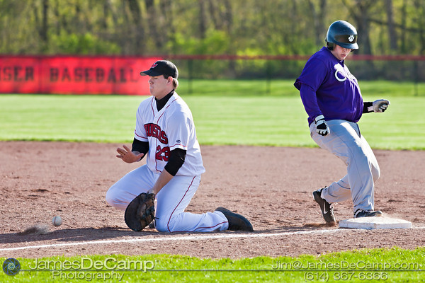 Pickerington Central High School's Alex Roesch (13) and Groveport Madison High School Ridge Vance (23) in the fourth inning of play at the Groveport Madison High School Baseball fields Thursday afternoon April 21, 2011.  (© James D. DeCamp | 614-367-6366 | http://www.JamesDeCamp.com)