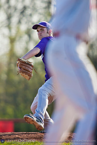 Pickerington Central High School's Zach Beaver (10) closes out the fifth inning pitching against Groveport Madison High School at the Groveport Madison High School Baseball fields Thursday afternoon April 21, 2011.  (© James D. DeCamp | 614-367-6366 | http://www.JamesDeCamp.com)