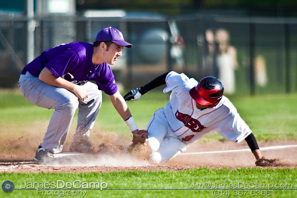 Pickerington Central High School's third baseman Zach Beaver (10), left, tags out Groveport Madison High School's Miguel Garcia (9) in the third inning of play at the Groveport Madison High School Baseball fields Thursday afternoon April 21, 2011.  (© James D. DeCamp | 614-367-6366 | http://www.JamesDeCamp.com)