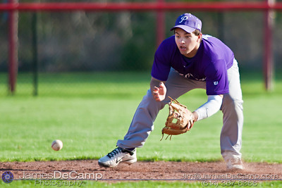Pickerington Central High School's Greg Basalyga (1) scoops up and throws a recovered grounder to first base to beat the Groveport Madison High School runner in the fourth inning of play at the Groveport Madison High School Baseball fields Thursday afternoon April 21, 2011.  (© James D. DeCamp | 614-367-6366 | http://www.JamesDeCamp.com)