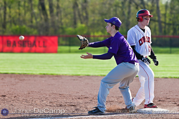 Pickerington Central High School's Ty Clouse (4) and Groveport Madison High School Andrew Downing (22) in the fourth inning of play at the Groveport Madison High School Baseball fields Thursday afternoon April 21, 2011.  (© James D. DeCamp | 614-367-6366 | http://www.JamesDeCamp.com)