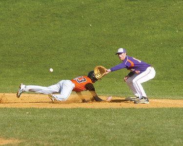 Milton's Brady Chappell slides back to first with Danville's Tyler Grubb covering the bag.