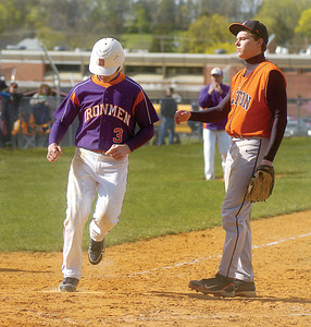 Danville's Bret Berg crosses home after a wild by by Milton's Cody Shaffer.