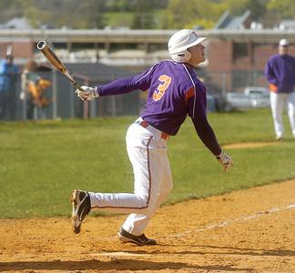 Bret Berg watches the ball after hitting it during Wednesday game at Milton.