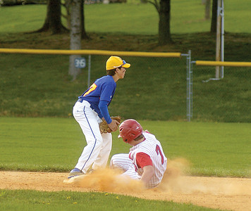 Line Mountain's Kellan Masser waits for the throw while Selinsgrove's Alex Moyer slides into 2nd base.