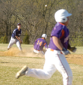 Mifflinburg's Patrick Crissman throws to first after forcing out Danville's Tyler Grubb, while Danville's Tyler Jenkins trys to beat the throw.