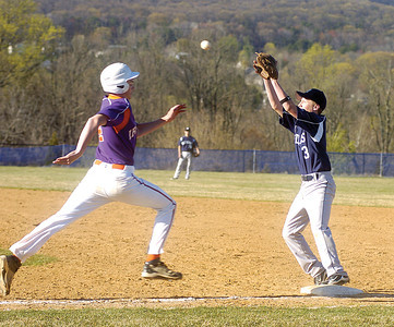 Danville's Tyler Brubb tries to outrun the throw as MIfflinburg's Patrick Crissman covers first base.