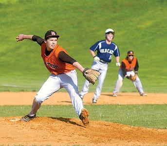 Milton's Cody Shaffer pitches against Mifflinburg on Wednesday.  MIfflinburg's Daniel Danowky is the runner on first, with Milton's Daniel Bridge playing first.