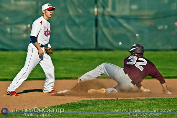 Columbus Academy High School's Zach Ratcliff (32) steals second base in the third inning of play as Hartley's Adam Zevichik (16) waits for the ball Monday evening March 26, 2012. (© James D. DeCamp | http://www.JamesDeCamp.com | 614-367-6366)