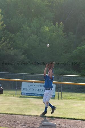 Alec Couture makes a ctach at shortstop.