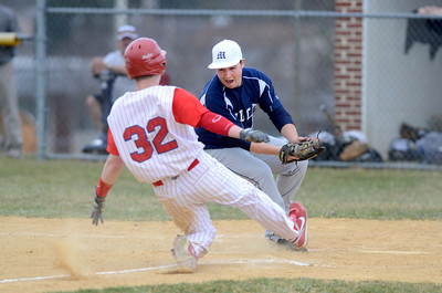Mifflinburg pitcher Oakley Whitsel covers home plate and puts the tag on Selinsgrove's Isaiah Rapp for an out during Monday's game in Selinsgrove.