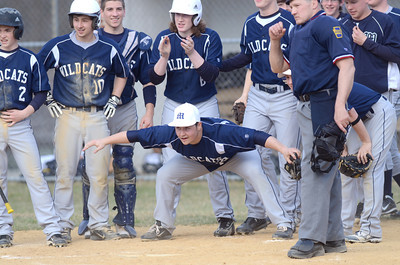 Members of the Mifflinburg baseball team wait at home plate to celebrate a home run during Monday's game against Selinsgrove.