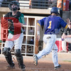 Max McDougald, infielder for the Vienna River Dogs easily scores a run.