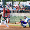 Outfielder for the Big Train Cody Brown lets a low and outside pitch pass without a swing.