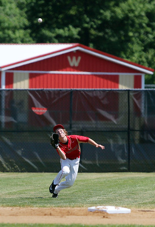 STEPHEN BROOKS | THE GOSHEN NEWS<br /> Westview senior outfielder Zach Schrock dives to make a catch during Monday's 2A sectional championship game against Bremen at Westview. Bremen won 7-6 in 10 innings.