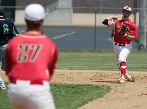 STEPHEN BROOKS | THE GOSHEN NEWS<br /> Westview senior shortstop Derrike Johns, right, throws to senior first baseman Chase Anderson, left, during Monday's 2A sectional championship game against Bremen at Westview. Bremen won 7-6 in 10 innings.