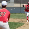 STEPHEN BROOKS   THE GOSHEN NEWS<br /> Westview senior shortstop Derrike Johns, right, throws to senior first baseman Chase Anderson, left, during Monday's 2A sectional championship game against Bremen at Westview. Bremen won 7-6 in 10 innings.