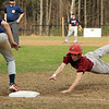Fitchburg's Brian Berthume dives back to first base safely at of the pickoff throw to North Middlesex first baseman Richie Sharp. SENTINEL & ENTERPRISE / SCOTT LAPRADE