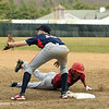 Fitchburg's Darius Flowers slides safely back to first ahead of the throw to North Middlesex's Richie Sharp. SENTINEL & ENTERPRISE / SCOTT LAPRADE