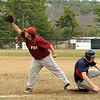 Fitchburg first baseman Antonio Cruz stretches to force out North Middlesex's Tyler McDonald. SENTINEL & ENTERPRISE / SCOTT LAPRADE