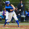 Leominster's Brett Corliss drives the ball for a single. SENTINEL & ENTERPRISE / GARYFOURNIERPHOTOGRAPHY.COM