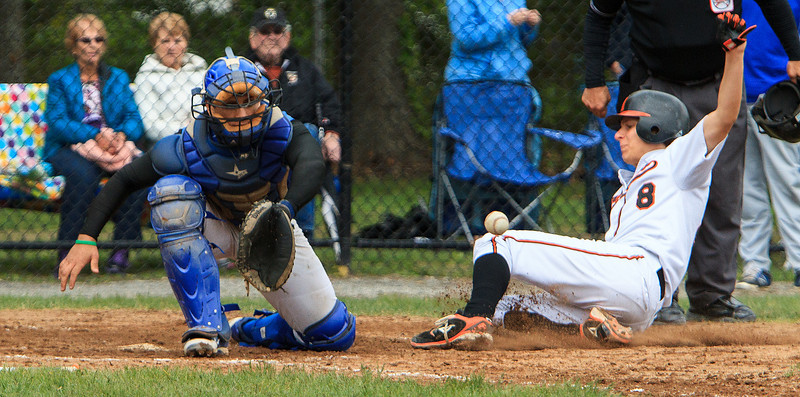 Marlboro's John Rumney slides home ahead of the throw to Leominster catcher Nick Cordio. SENTINEL & ENTERPRISE / GARYFOURNIERPHOTOGRAPHY.COM