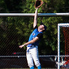 Leominster's left fielder Jay Valera leaps in vain to rob a home run during Monday's game against Shepherd Hill.<br /> SENTINEL & ENTERPRISE/GARY FOURNIER