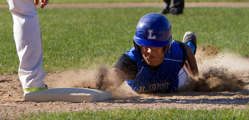 Danny Hernandez dives back to first base to avoid an attempted pickoff play during Monday's game against Shepherd Hill.<br /> SENTINEL & ENTERPRISE/GARY FOURNIER