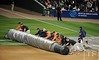 Oct 17, 2012; Detroit, MI, USA; Members of the grounds crew cover the field with a tarp as incoming inclement weather delays the start of game four of the 2012 ALCS between the New York Yankees and the Detroit Tigers at Comerica Park.   Mandatory Credit: Tim Fuller-USA TODAY Sports