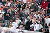 Oct 13, 2011; Detroit, MI, USA; Detroit Tigers first baseman Miguel Cabrera (24) attempts to catch a foul ball during the first inning of game five of the 2011 ALCS against the Texas Rangers at Comerica Park.  Mandatory Credit: Tim Fuller-US PRESSWIRE