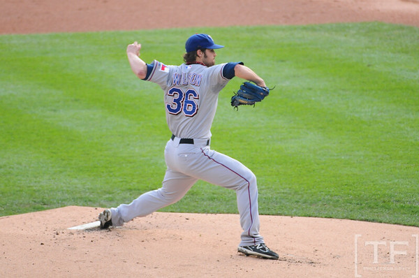 Oct 13, 2011; Detroit, MI, USA; Texas Rangers starting pitcher C.J. Wilson (36) pitches in the first inning against the Detroit Tigers of game five of the 2011 ALCS at Comerica Park.  Mandatory Credit: Tim Fuller-US PRESSWIRE