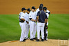 Oct 13, 2011; Detroit, MI, USA; Detroit Tigers pitching coach Jeff Jones (blue) talks to relief pitcher Phil Coke (center) and the infielders in the ninth inning of game five of the 2011 ALCS against the Texas Rangers at Comerica Park.  Mandatory Credit: Tim Fuller-US PRESSWIRE