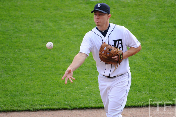 Oct 13, 2011; Detroit, MI, USA; Detroit Tigers third baseman Brandon Inge (15) throws a baseball to the fans in the second inning against the Texas Rangers of game five of the 2011 ALCS at Comerica Park.  Mandatory Credit: Tim Fuller-US PRESSWIRE