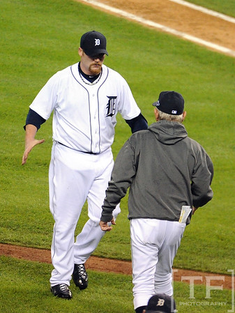 Oct 16, 2012; Detroit, MI, USA; Detroit Tigers relief pitcher Phil Coke (left) celebrates with manager Jim Leyland after game three of the 2012 ALCS against the New York Yankees at Comerica Park.  The Tigers won 2-1. Mandatory Credit: Tim Fuller-USA TODAY Sports
