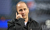 Oct 16, 2012; Detroit, MI, USA; New York Yankees general manager Brian Cashman on the phone before game three of the 2012 ALCS against the Detroit Tigers at Comerica Park.  Mandatory Credit: Tim Fuller-USA TODAY Sports