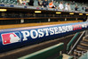 Oct 16, 2012; Detroit, MI, USA; A general view of the MLB postseason logo on the dugout rail before game three of the 2012 ALCS between the New York Yankees and Detroit Tigers at Comerica Park.  Mandatory Credit: Tim Fuller-USA TODAY Sports
