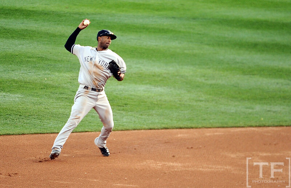 Oct 18, 2012; Detroit, MI, USA; New York Yankees shortstop Eduardo Nunez fields an RBI infield single hit by Detroit Tigers outfielder Avisail Garcia (not pictured) in the third inning during game four of the 2012 ALCS at Comerica Park.   Mandatory Credit: Tim Fuller-USA TODAY Sports
