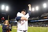 Oct 18, 2012; Detroit, MI, USA; Detroit Tigers relief pitcher Phil Coke pumps his fist as he leaves the field while holding a baby after game four of the 2012 ALCS against the New York Yankees at Comerica Park.  The Tigers won 8-1 to sweep the series and advance to the World Series.  Mandatory Credit: Tim Fuller-USA TODAY Sports
