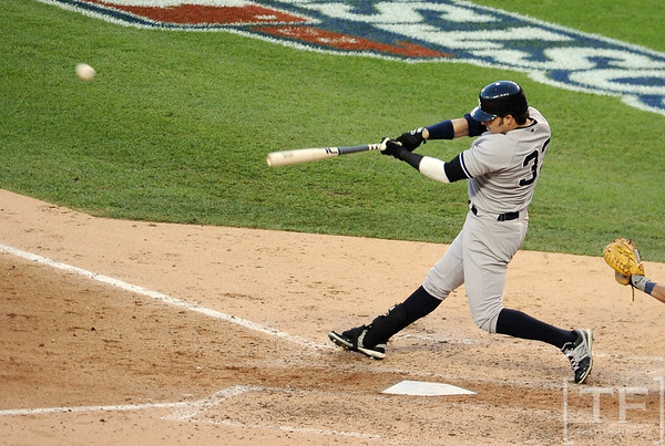 Oct 18, 2012; Detroit, MI, USA; New York Yankees right fielder Nick Swisher (33) hits a RBI double against the Detroit Tigers in the 6th inning during game four of the 2012 ALCS at Comerica Park.   Mandatory Credit: Tim Fuller-USA TODAY Sports