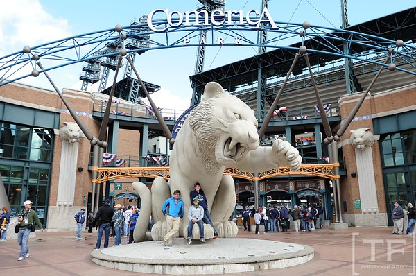 Oct 18, 2012; Detroit, MI, USA; Baseball fans Miles DeVoogd , Max DeVoogd and Chance Eigenauer pose for a photo under the tiger sculpture before game four of the 2012 ALCS between the Detroit Tigers and New York Yankees at Comerica Park.   Mandatory Credit: Tim Fuller-USA TODAY Sports