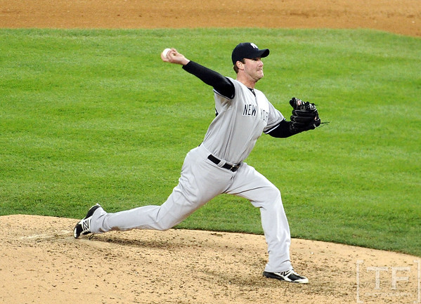 Oct 18, 2012; Detroit, MI, USA; New York Yankees relief pitcher Derek Lowe throws a pitch against the Detroit Tigers in the 7th inning during game four of the 2012 ALCS at Comerica Park.   Mandatory Credit: Tim Fuller-USA TODAY Sports