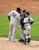Oct 18, 2012; Detroit, MI, USA; New York Yankees starting pitcher CC Sabathia (52) talks with catcher Russell Martin (55) with pitching coach Larry Rothschild (middle) against the Detroit Tigers in the third inning during game four of the 2012 ALCS at Comerica Park.   Mandatory Credit: Tim Fuller-USA TODAY Sports
